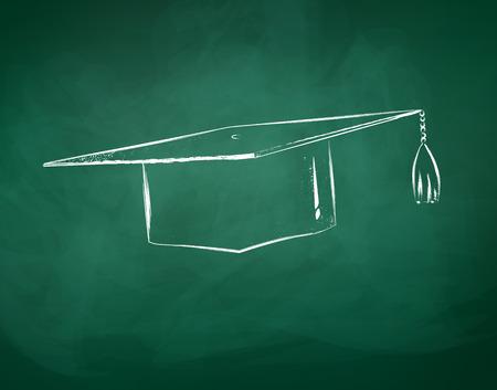 Graduation cap drawn on green chalkboard.