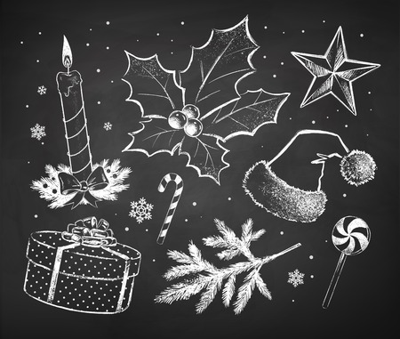 Chalked Christmas sketches collection drawn on black chalkboard background.