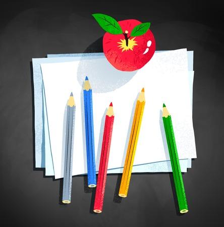 色の鉛筆と紙を置くアップル