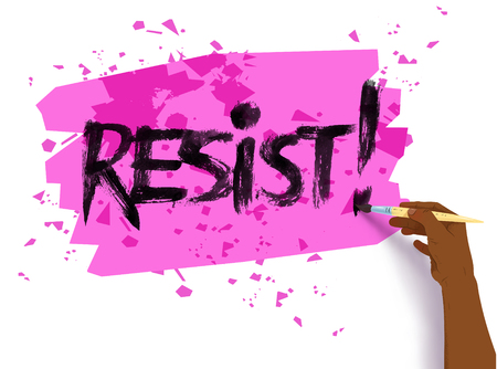 Female hand writing Resist slogan