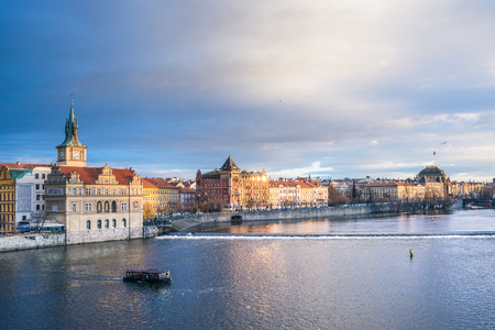 central europe: The view from the Charles bridge over the Vltava river, Smetana embankment and dramatic sky on a winter day. Prague, Czech Republic, Central Europe Stock Photo