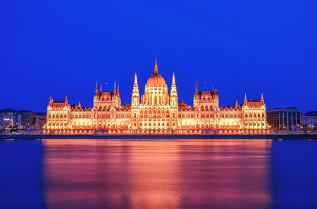 The historical building of Hungarian Parliament during the blue hour after the sunset shot from the Buda side of the Danube, front view