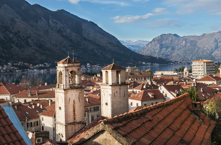 balkan peninsula: The view over the bay of Kotor, the two towers and the red roofs of the old town. Montenegro, the Balkan peninsula