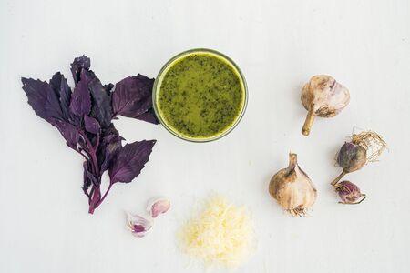 parmezan: Fresh homemade pesto sause and ingredients on a white board Stock Photo