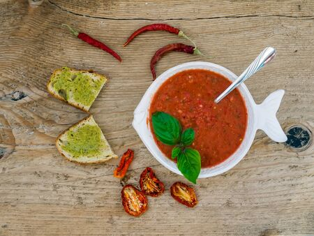 bawl: A bawl of tomato soup on a wooden background Stock Photo