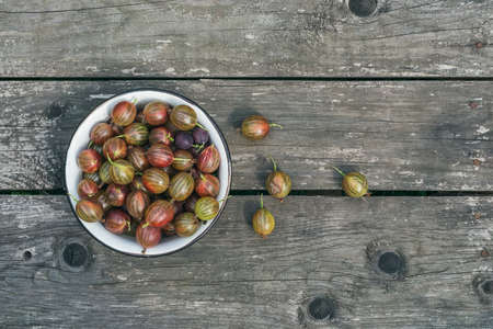 bawl: A bawl of ripe gooseberries on a wooden surface Stock Photo