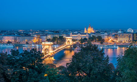 The view of the Chain bridge, Saint Istvans basilica and the Danube in Budapest from the Buda castle area in the evening lights photo