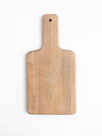 cutting: Rustic wooden cutting board on a white background. Top view