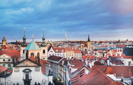 stare mesto: The view over the red roofs of Stare Mesto district in Prague, Czech Republic, from the view point on top of the tower of the Charles bridge in winter