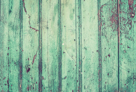 Old rustic painted cracky green or turquoise wooden texture