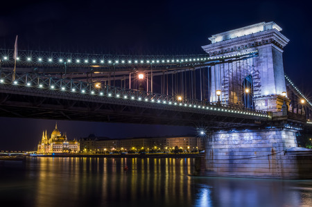 Parlament: The night view of the Parlament building and the Danube under the Chain bridge in Budapest, Hungary