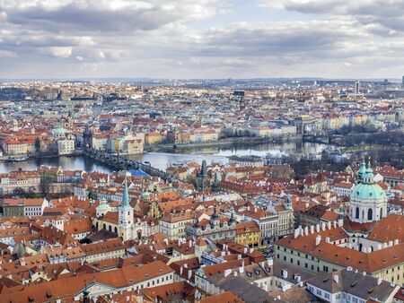 The view over Prague and the Charles bridge from the Saint Vitus Cathedral photo