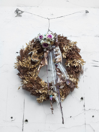 artificial lights: Holiday christian wreath on the white door