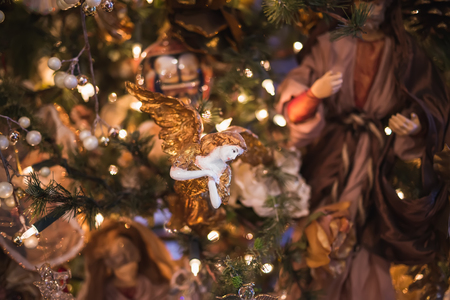 angel tree: Christmas tree decoration with a porcelain angel. Selective focus Stock Photo