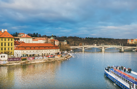 central europe: Prague, Czech Republic, Central Europe, 25.12.2014: the view from Charles bridge over the Vltava river, Mala Strana side, Kampa island and a cruise boat with people onboard having fun Editorial