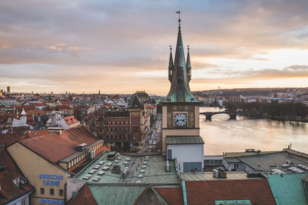 Prague, Czech Republic, Central Europe, 25.12.2014: the view from the top of the Charles bridge tower over the old town center of the Czech capital at the sunset time in winter