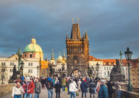 tourist spot: Prague, Czech Republic, Central Europe, 25.12.2014: Charles bridge crowded with locals and tourists on a Christmas day