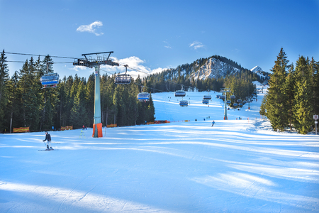 top 7: Garmisch-Partenkirchen, Germany - January 7, 2015: people skiing down the ski slope at the top point of Hausberg ski lift in bavarian Alps in January