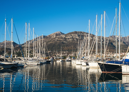 balkan peninsula: Ships in the yacht marine of Bar, Montenegro, Balkan peninsula. 13.01.2015: the view of yachts in the marina of Bar with mountains at the backdrop on a clear sunny winter day Editorial