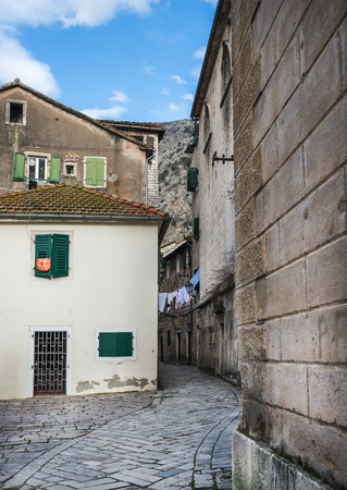 meandering: Kotor, Montenegro, 24.01.2015. Narrow meandering paved street of the old town of Kotor