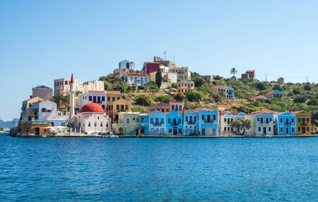 greece: Kastellorizo island, Dodecanese, Greece. Colorful Mediterranean architecture on a sunny clear day