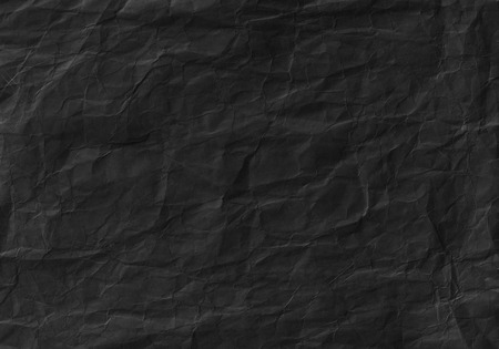 Black crumpled paper texture. Background, surface and wallpaper