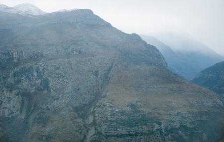 balkan peninsula: View over misty montain rock in the Moraca river canyon in north Montenegro, Balkan peninsula, in winter Stock Photo