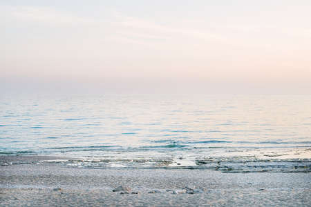 peaceful scene: Peaceful scene of a calm sea at sunset, pastel colors