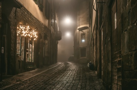 foggy: Old European narrow empty street of a medieval town on a foggy evening. Taken in Bergamo, Citta Alta