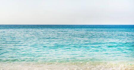 turkiye: All shades of marine blue. Turquoise clear blue sea water of Mediterranean sea at Cleopatra beach in Alanya, Antalya region, Turkey coast. Gradient of blue at Turkish Riviera