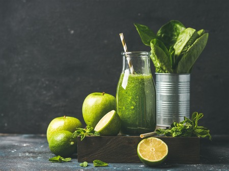 romaine lettuce: Green smoothie in bottle with apple, romaine lettuce, lime and mint, dark background, selective focus, copy space. Detox, dieting, clean eating, vegetarian, vegan, fitness or healthy lifestyle concept