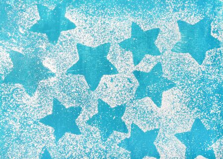Star shaped biscuits silhouettes over bright blue background, top view, copy space