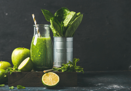 romaine lettuce: Green smoothie in bottle with apple, romaine lettuce, lime and mint, dark background, selective focus, copy space. Detox, dieting, clean eating, vegetarian, vegan, fitness healthy lifestyle concept