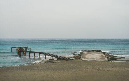 turkiye: Empty sandy coast at Mediterranean sea in winter after storm in Alanya, Turkey