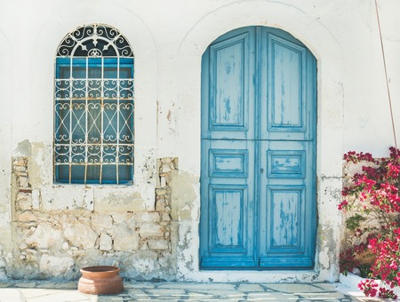 Typical exterior of Greek traditional town street with colorful buildings and marine blue door on Kastelorizo Island, Dodecanese, Greece, Europe
