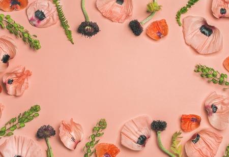 Floral pattern of pink and red flower petals, green branches and leaves on pink background. Flat lay, top view, copy space. Valentines or Women s day background. Flowers pattern texture Stock Photo