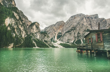 Lago di Braies or Pragser Wildsee in Fanes-Sennes-Braies Nature Park. Mountain lake with clear emerald waters in Valle di Braies in the Dolomite Alps in North Italy