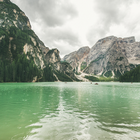 Lago di Braies or Pragser Wildsee in Fanes-Sennes-Braies Nature Park, square crop. Mountain lake with clear emerald waters in Valle di Braies in the Dolomite Alps in North Italy on gloomy day 版權商用圖片