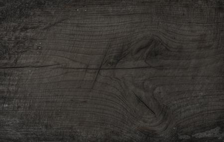 Altes rustikales entfärbtes hölzernes Brett. Dunkelgraue hölzerne Beschaffenheit, Tapete und Hintergrund. Braun-graue Textur, Oberfläche und Tapete