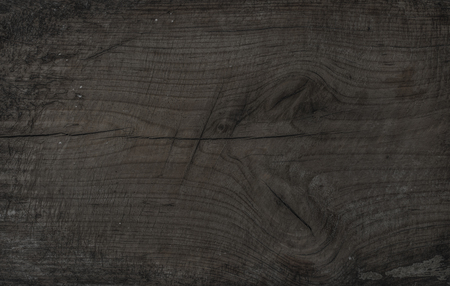 Old rustic discolored wooden board. Dark gray wooden texture, wallpaper and background. Brown-gray texture, surface and wallpaper Imagens