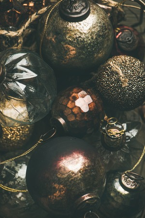 Flat-lay of vintage Christmas or New Year holiday tree decoration balls, top view. Holiday greeting card background, vertical composition Stock Photo