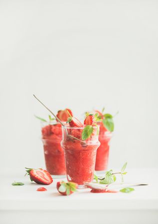 Healthy low calorie summer treat. Strawberry and champaigne granita, slushie or shaved ice dessert in glasses, white background, copy space. Clean eating, weight loss, vegan, dieting food concept