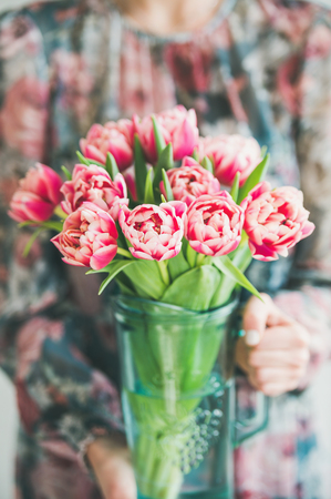Spring flowers arrangement woman in colorful silk dress holding spring flowers arrangement woman in colorful silk dress holding bouquet of fresh pink tulips mightylinksfo