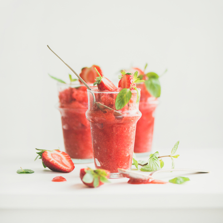 Healthy low calorie summer treat. Strawberry and champaigne granita, slushie or shaved ice dessert in glasses, white background, copy space, square crop. Clean eating, vegan, dieting food concept