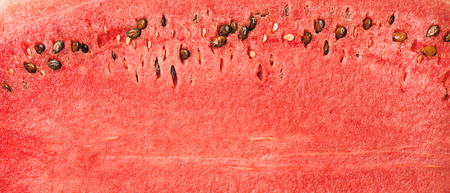 Juicy ripe watermelon texture. Ripe juicy summer fruit watermelon texture, wallpaper and background, top view. Stock Photo