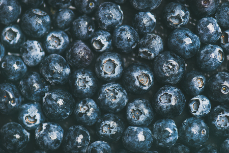 Fresh blueberry texture, wallpaper and background. Flat-lay of dark berries, top view. Summer food or local market produce concept 스톡 콘텐츠