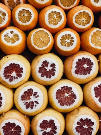 Oranges and grapefruit fruits for making fresh squized juice in the street of Istanbul, Turkey. Traditional street food. Healthy lifestyle and summer beverages.