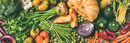 Healthy vegetarian seasonal Fall food cooking background. Flat-lay of Autumn vegetables and herb from local market over grey concrete background, top view, wide composition. Vegan, alkaline diet food 写真素材