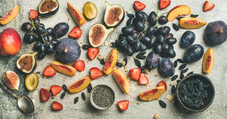 Healthy seasonal fall breakfast variety. Flat-lay of Greek yogurt, fresh fruit, chia seeds over grey concrete background, top view, copy space. Clean eating, dieting, vegetarian food