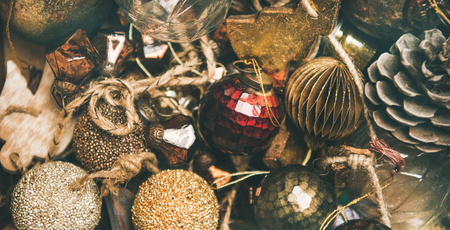 Christmas or New Year texture, wallpaper and background. Flat-lay of vintage Christmas tree decoration toys, balls and pine cones, top view, close-up, wide composition. Festive holiday mood